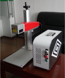 Chiny 20W Mini fiber laser marking machine for plastic PVC data matrix and barcode dystrybutor