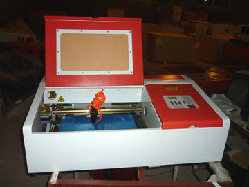 Chiny Desktop Laser Engraver Co2 Laser Engraving And Cutting Machine For Carving Chapter And Artistic Works fabryka